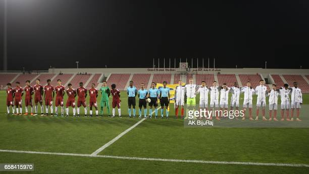 Players and referees line up ahead of the U18 International friendly match between England and Qatar at the Grand Hamad Stadium on March 27 2017 in...