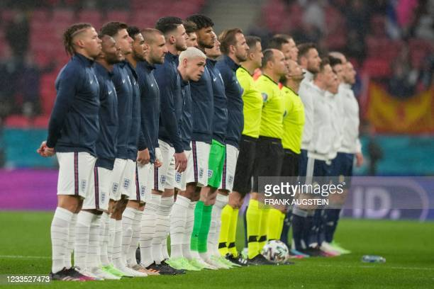 Players and referees line up before the start of the UEFA EURO 2020 Group D football match between England and Scotland at Wembley Stadium in London...