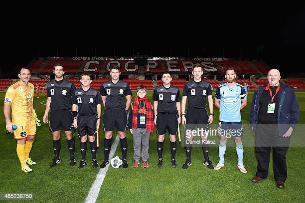 Players and referees pose for a photo prior to the the FFA Cup Round of 16 match between Adelaide United and Sydney FC at Coopers Stadium on August...