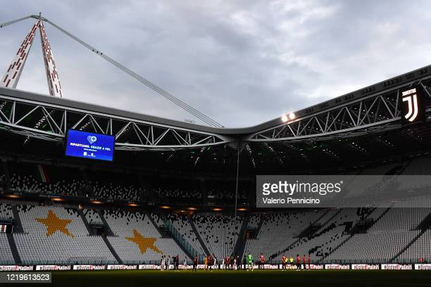 Players and referees stand for a minute of silence in honor of the victims of COVID-19 during the Coppa Italia Semi-Final Second Leg match between...