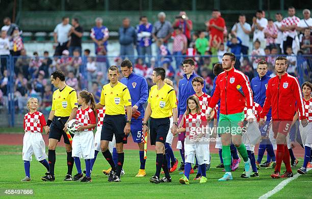 Players and referees walk onto the pitch before the UEFA U21 Championship Playoff Second Leg match between Croatia and England at the Stadion Hnk...