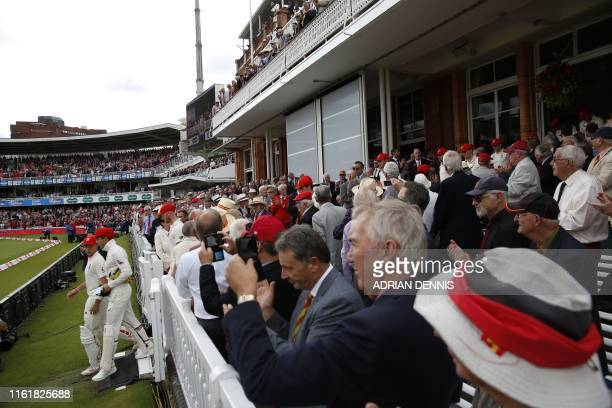Players and spectators wear red caps to show support for The Ruth Strauss Foundation set up in honour of Andrew Strauss's wife Ruth who died of...