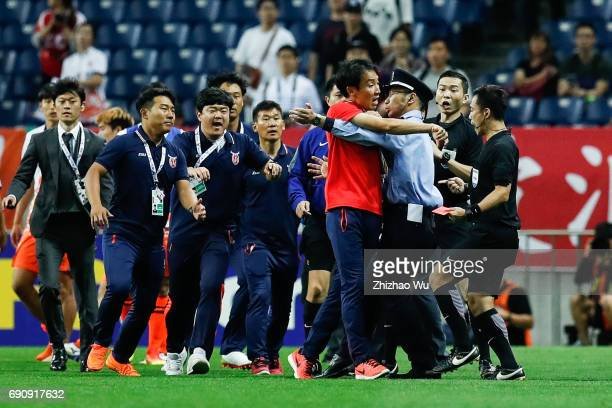 players and staff from both team come into a conflict during the AFC Champions League Round of 16 match between Urawa Red Diamonds and Jeju United FC...