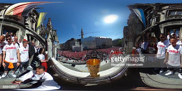 Players and staff of Bayern Muenchen celebrate winning the DFB German Cup title on the town hall balcony at Marienplatz on May 22 2016 in Munich...