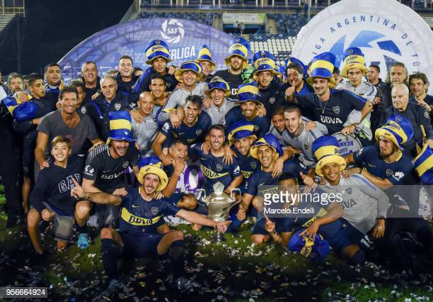 Players and staff of Boca Juniors pose with the trophy after winning the Superliga 2017/18 against Gimnasia y Esgrima La Plata at Estadio Juan...