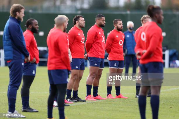 Players and staff of England participate in a minute silence in honour of Armistice Day during a training session ahead of their Autumn Nations Cup...