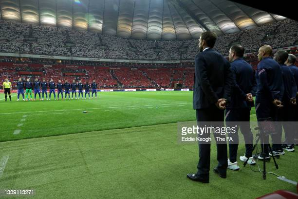 Players and staff of England stand for the national anthem prior to the 2022 FIFA World Cup Qualifier match between Poland and England at Stadion...