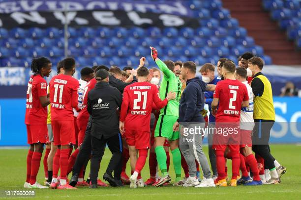 Players and Staff of Hertha BSC huddle during the Bundesliga match between FC Schalke 04 and Hertha BSC at Veltins-Arena on May 12, 2021 in...