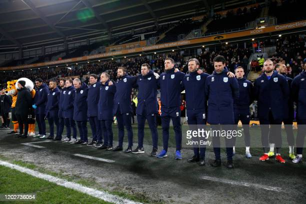 Players and staff of Huddersfield Town pay their respects to the loss of Jordan Sinnott during the Sky Bet Championship match between Hull City and...