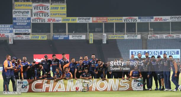 Players and Staff of India pose with the trophy after winning the ODI series during the 3rd One Day International match between India and England at...