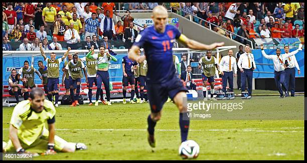 Players and staff of Netherlands already start to celebrate as Arjen Robben passes by Spain goalkeeper Iker Casillas during the FIFA World Cup 2014...