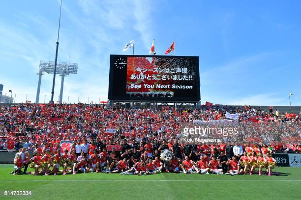 Players and staff of Sunwolves pose for photographs with fans after the Super Rugby match between the Sunwolves and the Blues at Prince Chichibu...