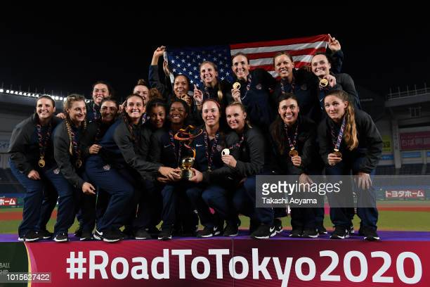 Players and Staff of United States celebrate with their gold medal and trophy after the awards ceremony at ZOZO Marine Stadium on day eleven of the...