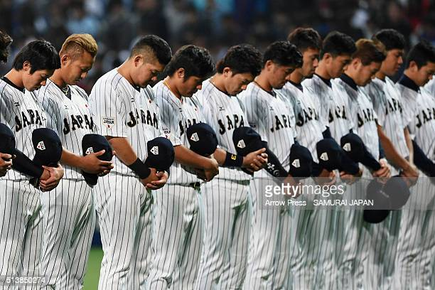 Players and staffs of Japan and Chinese Taipei observe a minute of silence for the victims of the Great East Japan Earthquake firve years ago and the...