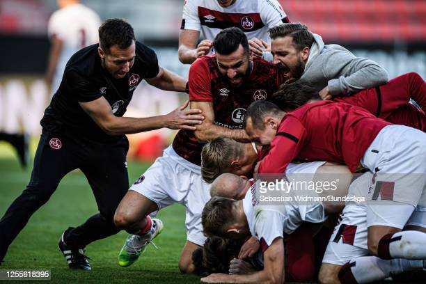 Players and support staff of Nürnberg celebrate after the 2. Bundesliga playoff second leg match between FC Ingolstadt and 1. FC Nürnberg at Audi...