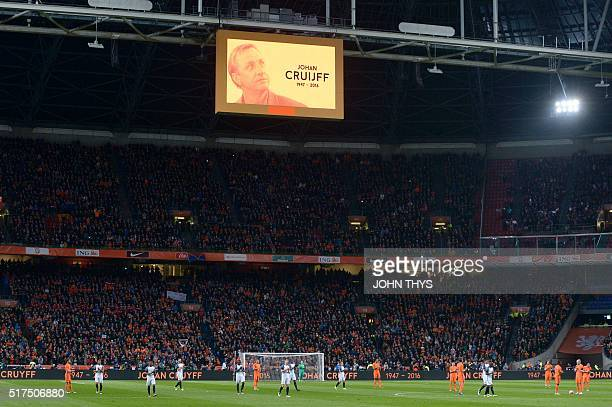 Players and supporters applaud during a standing ovation in honour of late Dutch football legend Johann Cruyff during a pause in the 14th minute of...