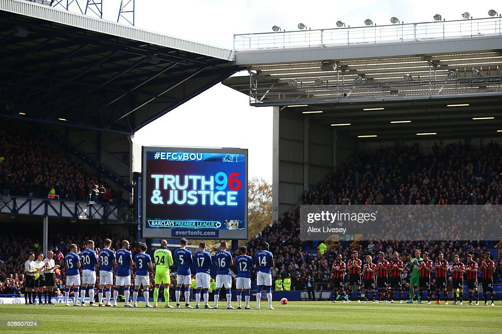 Players and supporters observe a minute of silence for the victims of the Hillsborough disaster prior to the Barclays Premier League match between Everton and A.F.C. Bournemouth at Goodison Park on April 30, 2016 in Liverpool, England.
