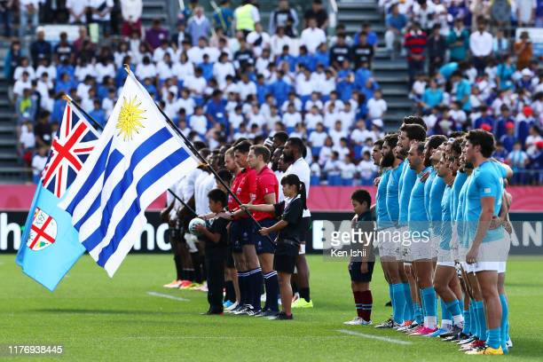 Players and supporters observe a minute of silent for the victims of the 2011 Great Eastern Japan Earthquake and following tsunami prior to the Rugby...