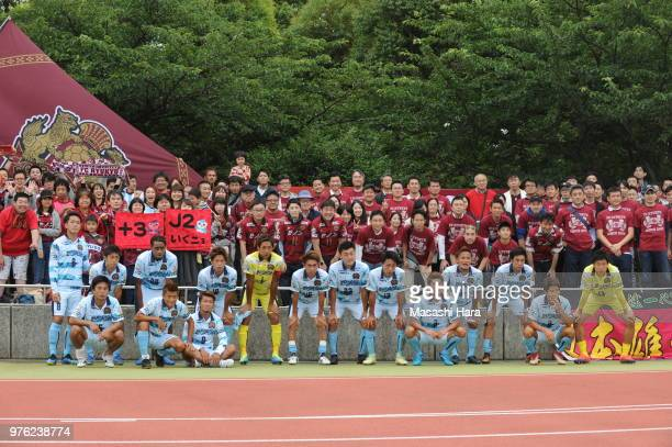Players and Supporters of FC Ryukyu pose for photograph after the J.League J3 match between FC Tokyo U-23 and FC Ryukyu at Yumenoshima Stadium on...