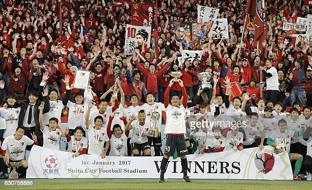 Players and supporters of Kashima Antlers celebrate after defeating Kawasaki Frontale in the Emperor's Cup final at Suita Stadium in Suita Osaka...