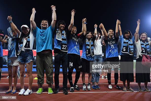 Players and supporters of Kawasaki Frontale celebrate the win after the J.League match between Kawasaki Frontale and Ventforet Kofu at the Todoroki...