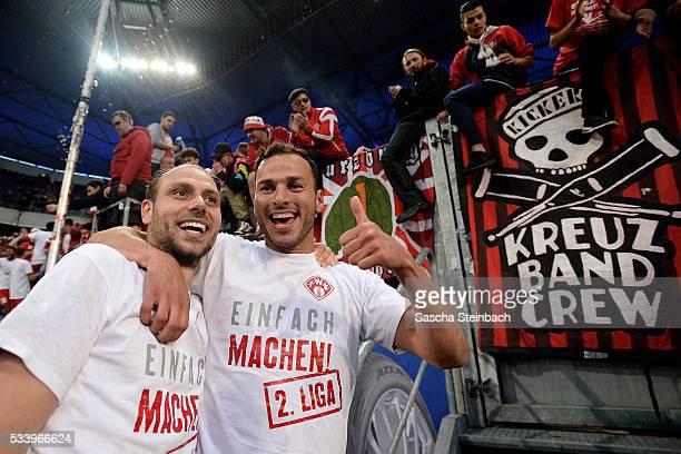 Players and supporters of Wuerzburg celebrate after winning the 2 Bundesliga playoff leg 2 match against MSV Duisburg at SchauinslandReisenArena on...