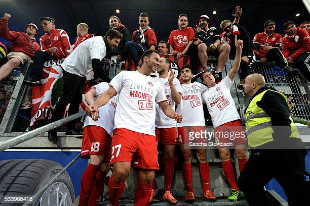 Players and supporters of Wuerzburg celebrate after winning the 2 Bundesliga playoff leg 2 match against MSV Duisburg at SchauinslandReisenArena on...