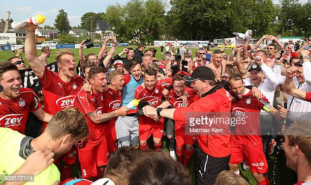 Players and Supporters of Zwickau celebrate after winning the Regionalliga Nordost championship title after the Regionalliga Nordost match between FC...