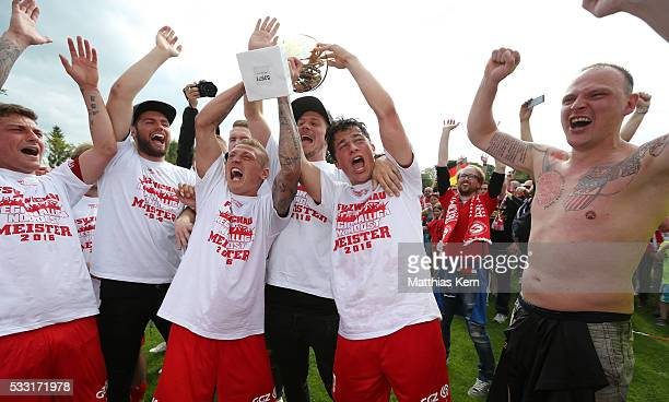 Players and Supporters of Zwickau celebrate with the trophy after winning the Regionalliga Nordost championship title after the Regionalliga Nordost...