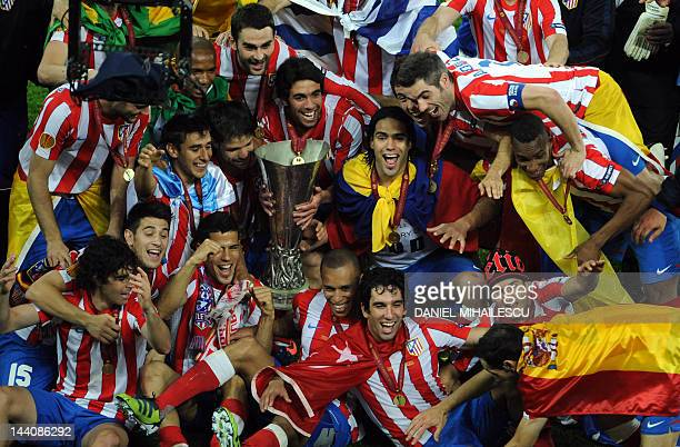 Players and team members of Atletico Madrid celebrate with the trophy after winning the UEFA Europa League final football match between Club Atletico...
