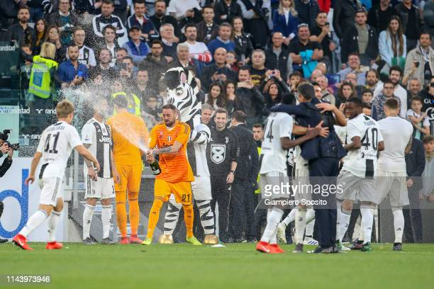 Players and team members of Juventus celebrate after winning the Italian league at the end of the Serie A match between Juventus and ACF Fiorentina...