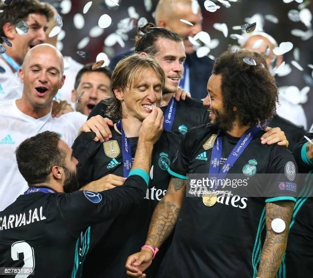 Players and the technical team of Real Madrid celebrate after winning the UEFA Super Cup title in the final match against Manchester United at the...