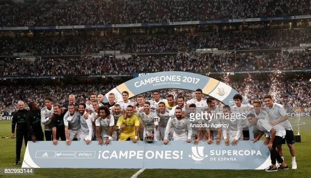 Players and the technical team of Real Madrid pose for a photo as they celebrate winning the Spanish Super Cup in the return match against Barcelona...