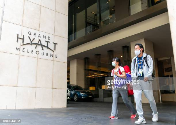 Players and their entourages emerge from the Grand Hyatt Hotel in Melbourne on February 04, 2021 in Melbourne, Australia. Victoria has reintroduced...