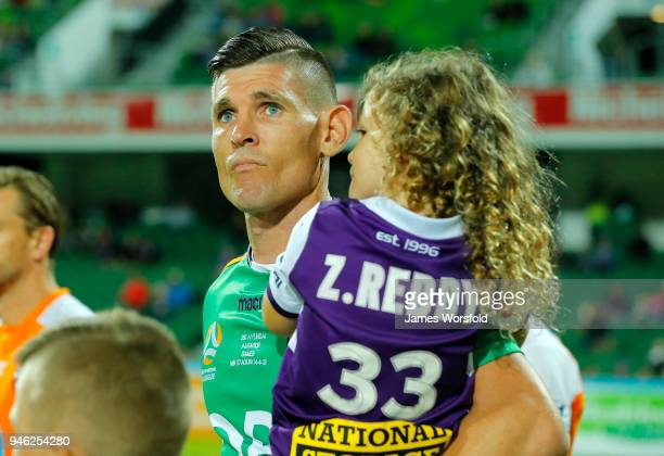 Players and their kids walk out to the field before the start of play during the round 27 ALeague match between the Perth Glory and the Brisbane Roar...