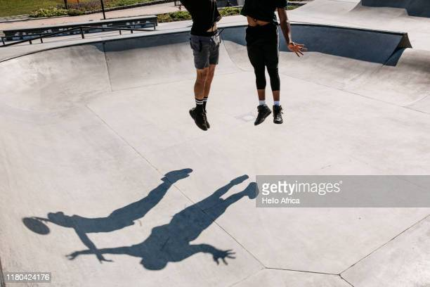 Players and their shadows jump for the ball