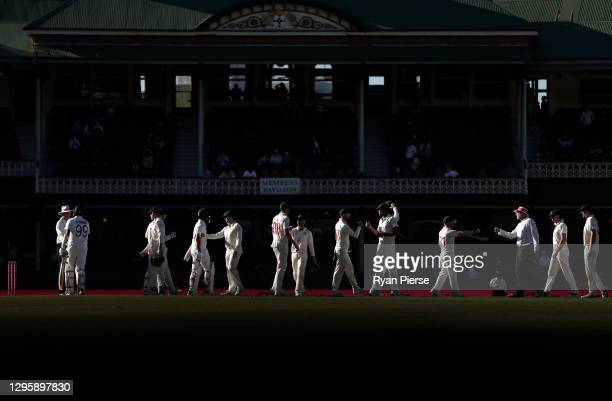 Players and Umpires congratulate each other as the match ended in a draw during day five of the 3rd Test match in the series between Australia and...