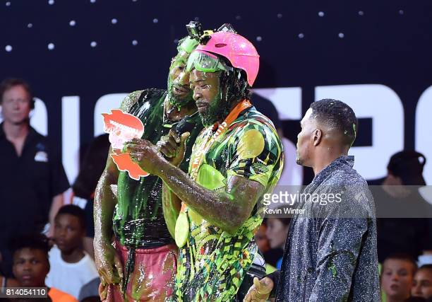 NBA players Andre Drummond and DeAndre Jordan react after getting slimed with TV personality Michael Strahan during Nickelodeon Kids' Choice Sports...