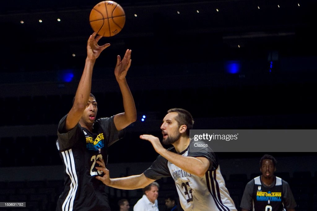 Players Anthony Davis and Ryan Anderson in action during a training session of New Orleans Hornets and Orlando Magic with disabled people at Arena on October 06, 2012 in Mexico City, Mexico.