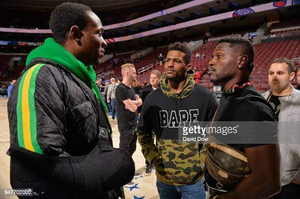 NFL players Antonio Brown Mike Wallace and Alshon Jeffery speak after the game between Miami Heat and Philadelphia 76ers in Game Two of Round One of...