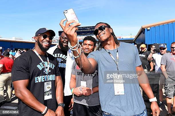 NFL players Antwione Williams A'Shawn Robinson Ian Wells and Ezekiel 'Ziggy' Ansah of the Detroit Lions tour the garage area before the NASCAR Sprint...