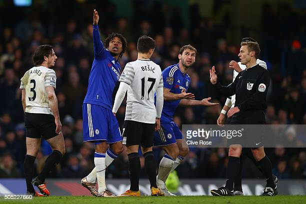 Players appeal to referee Mike Jones during the Barclays Premier League match between Chelsea and Everton at Stamford Bridge on January 16 2016 in...