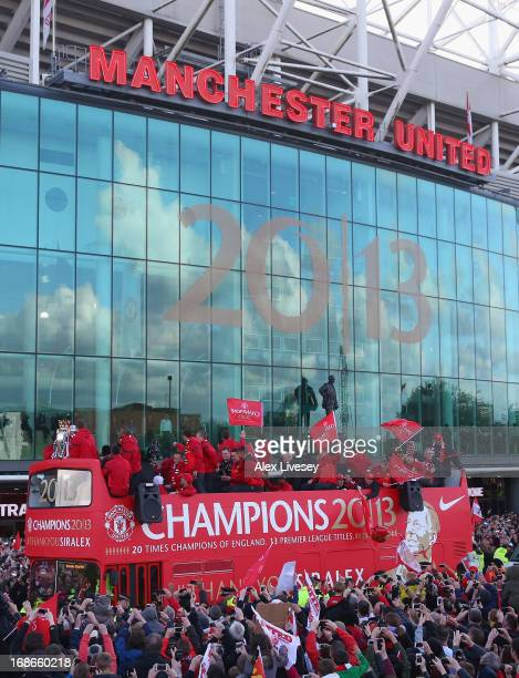 Players appear on the open topped bus outside Old Trafford during the Manchester United Premier League winners parade on May 13 2013 in Manchester...