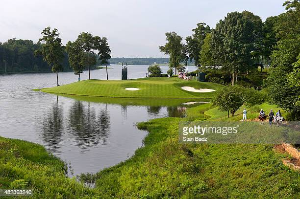 Players approach the 11th hole during the first round of the Quicken Loans National at Robert Trent Jones Golf Course on July 30, 2015 in...