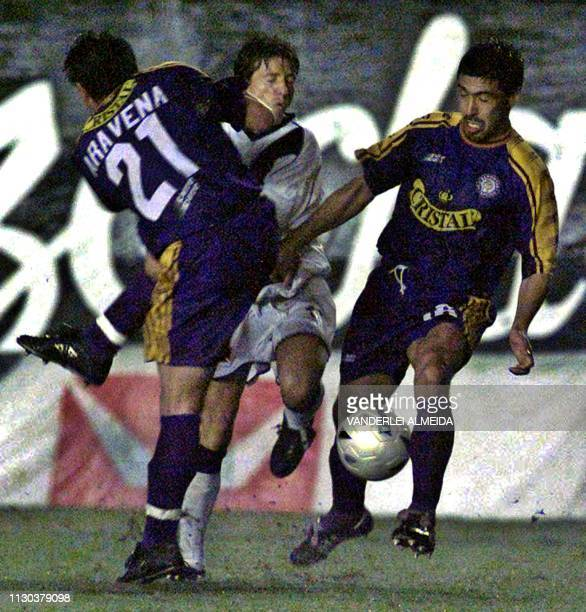 Players Araveno and Consino of the team Deportivo Concepcion de Chile fight for the ball with Juninho Paulista of Vasco da Gama in a qualifying match...