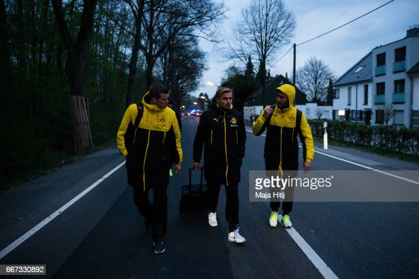 Players are escorted after the team bus of the Borussia Dortmund football club was damaged in an explosion on April 11 2017 in Dortmund Germany...