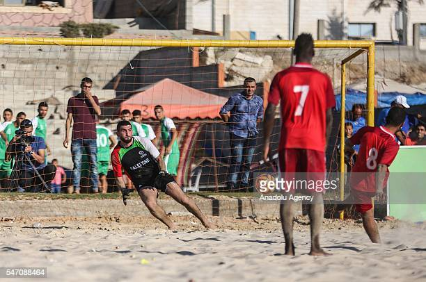 Players are in action during the Palestine Football Association's 1th Beach soccer league match between Khadamat Khanyounis and Al Sadaka in Gaza...