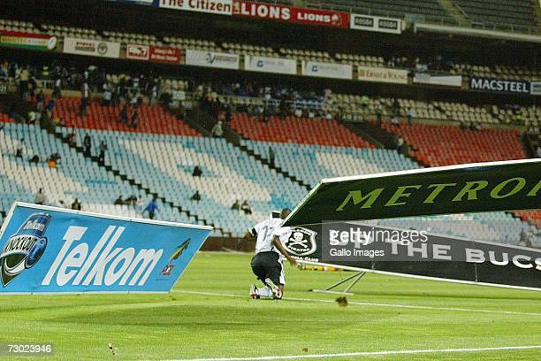 Players are injured as strong winds blow advertising boards onto the pitch during the PSL match between the Orlando Pirates and the Black Leopards at...