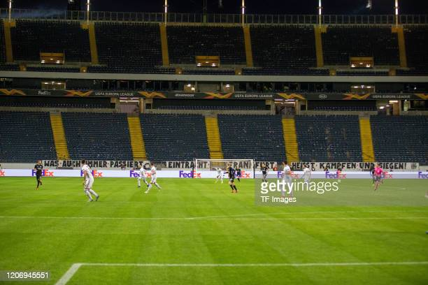 Players are seen behind the empty stadium during the UEFA Europa League round of 16 first leg match between Eintracht Frankfurt and FC Basel at...