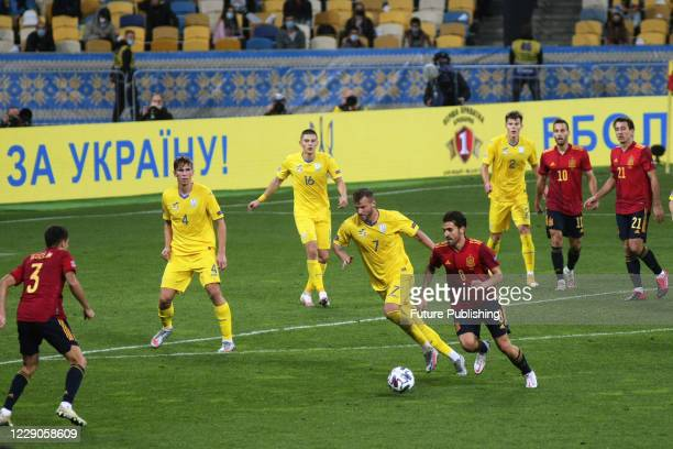 Players are seen in action during the UEFA Nations League game between the national football teams of Ukraine and Spain at the NSC Olimpiyskyi, Kyiv,...